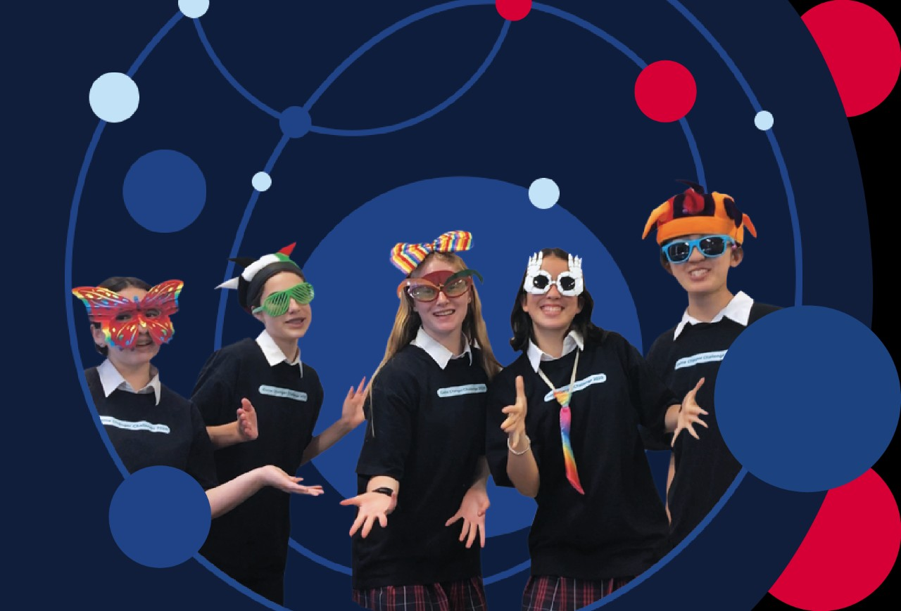 Five students, smiling while wearing novelty glasses and hats.